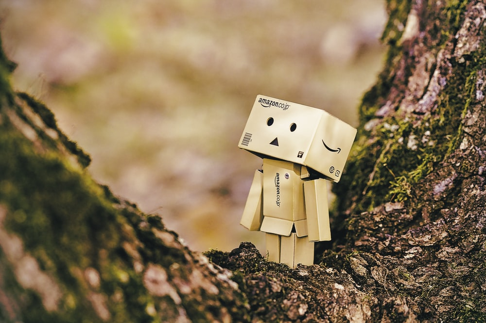 cardboard robot toy on wooden tree