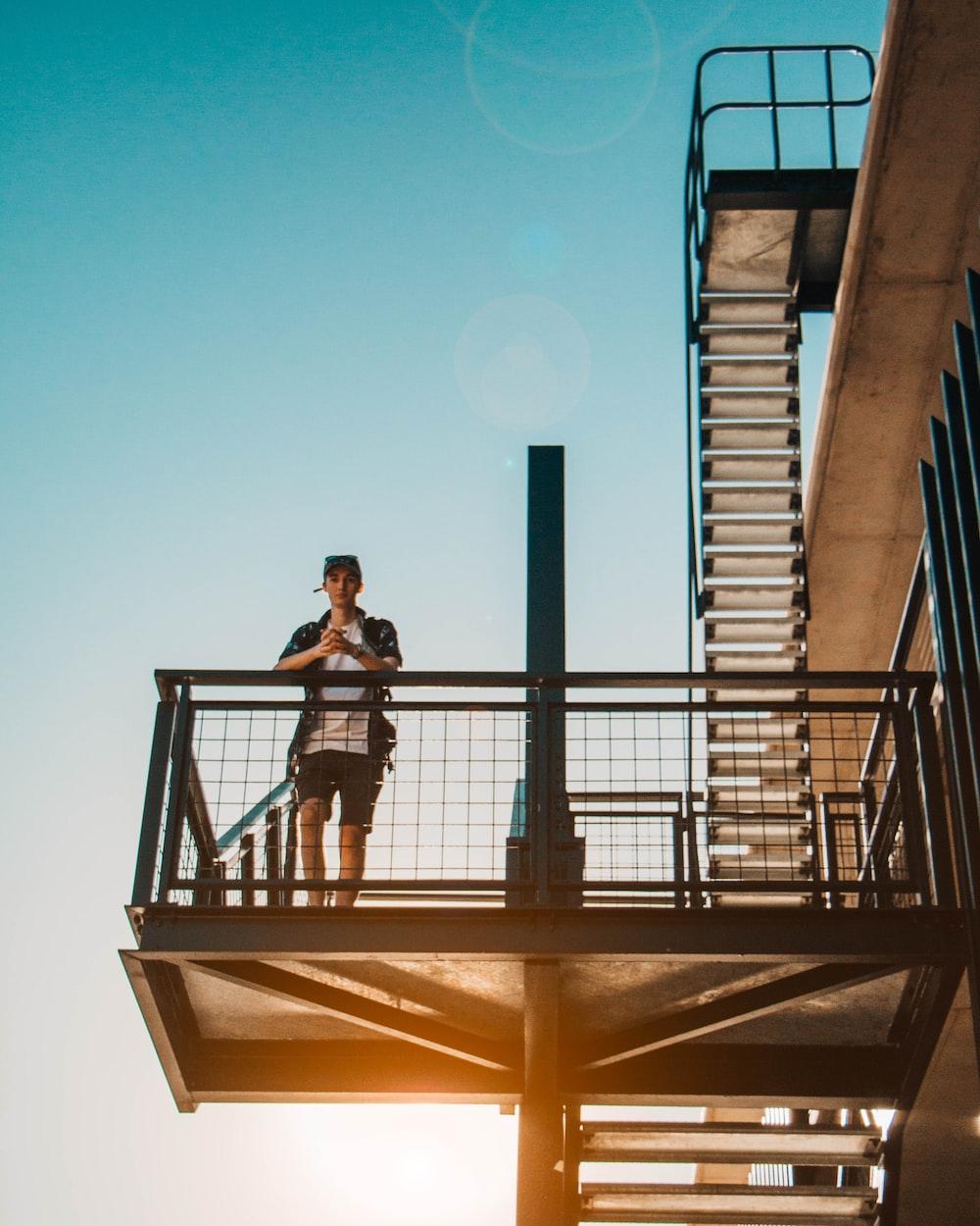 man leaning on balustrade