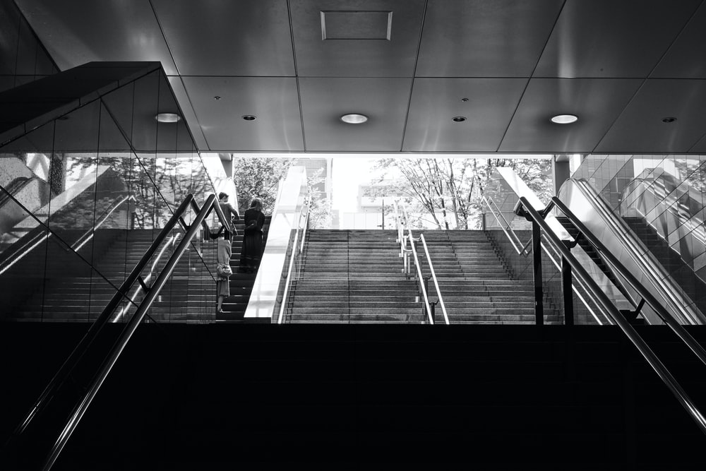 grayscale photo of subway stairs