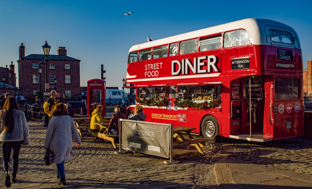 red double deck bus Diner street food park near buildings
