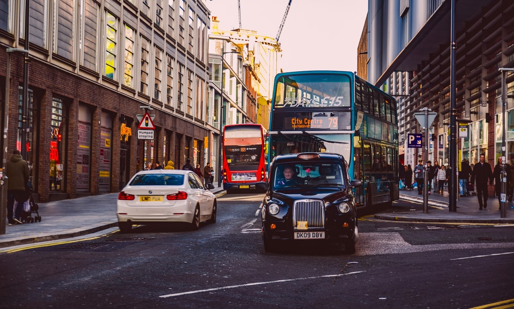 cars and buses on the streets of the cityt