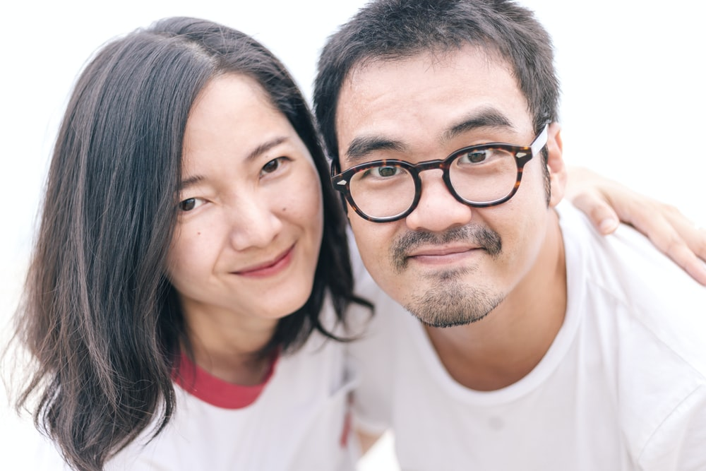 couple wears white shirts