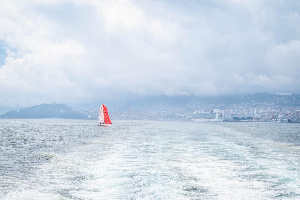 sailboat at the ocean near city