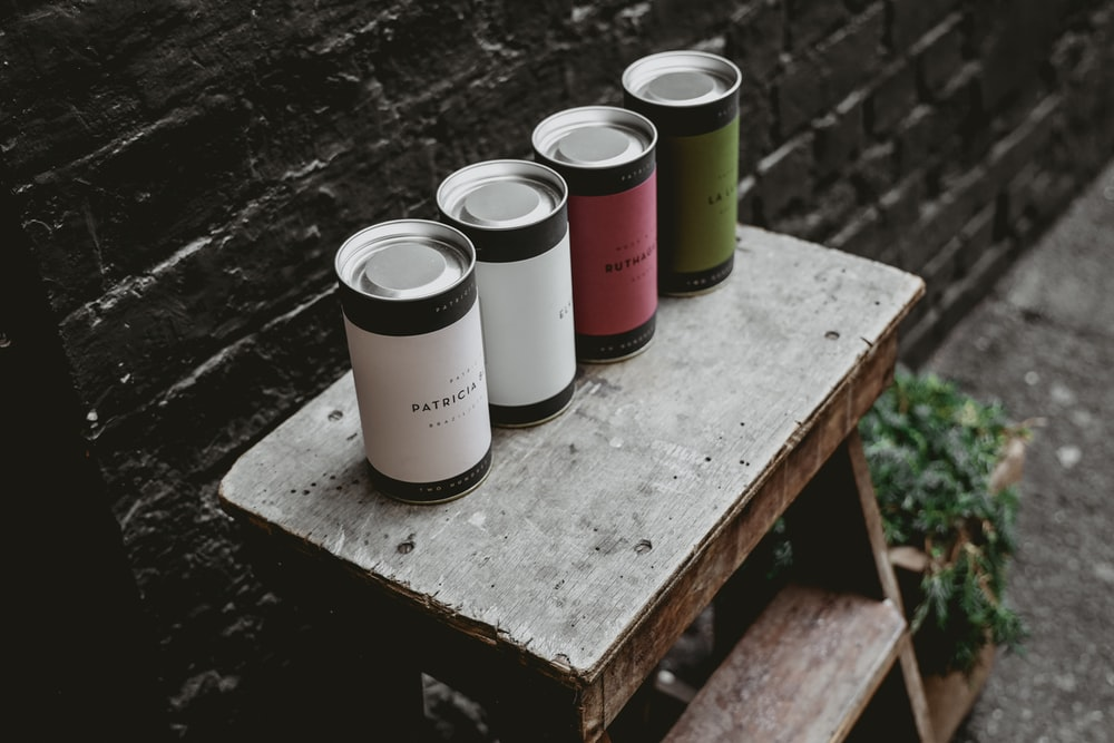 four tin cans on step ladder