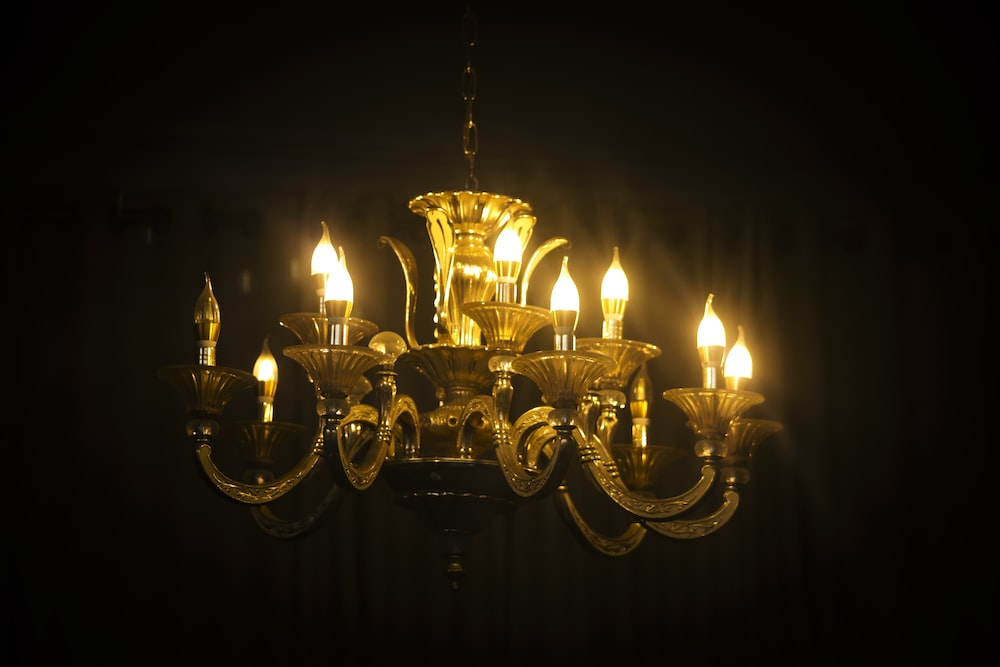 brass-colored uplight chandelier turned-on