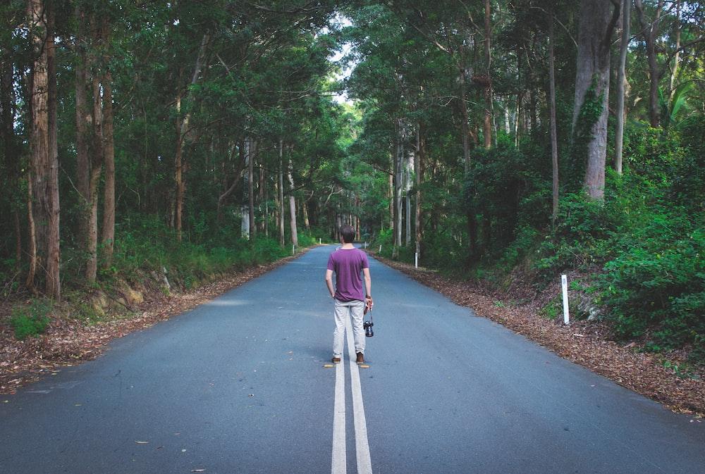 man standing on highway