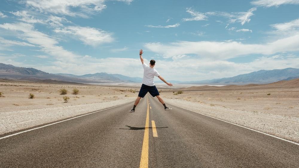 man jumping during daytime