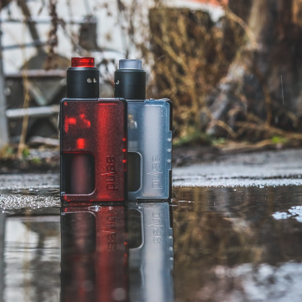 two red and gray variable box mods