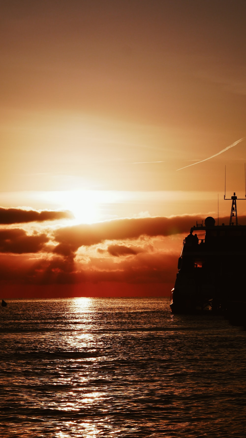 ship floating at the ocean during golden hour