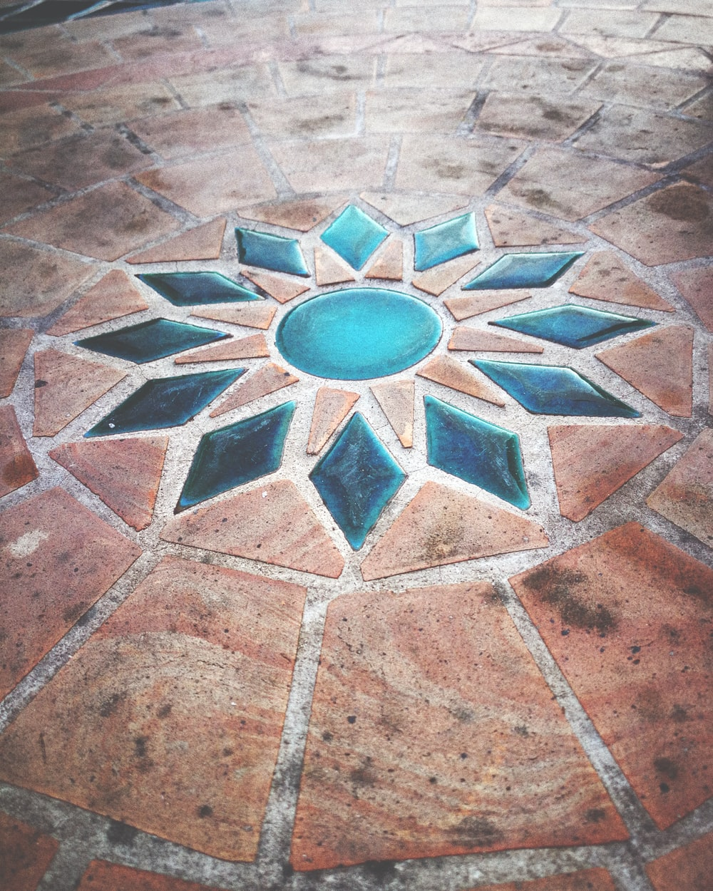 blue and brown flower tile