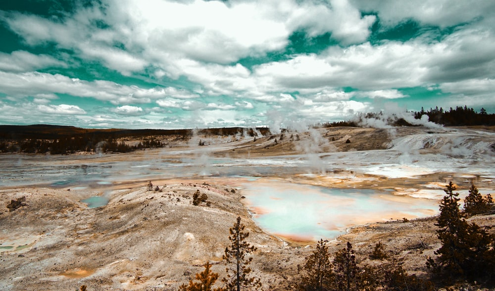 panoramic photography of geyser field during daytime