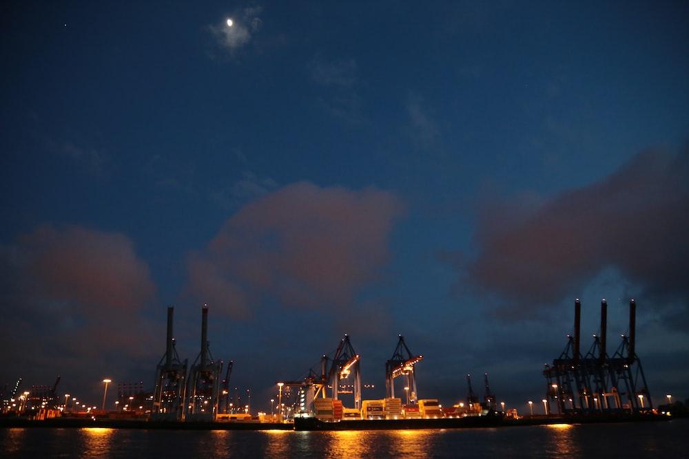 buildings near ocean during nighttime