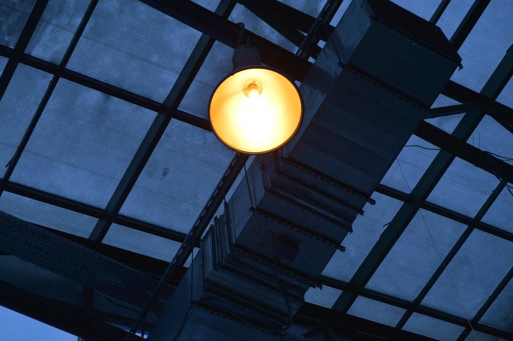 black pendant lamp turned-on