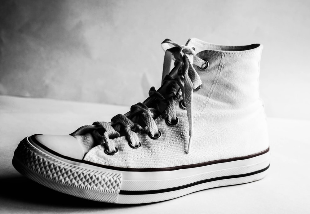 grayscale photography of shoe