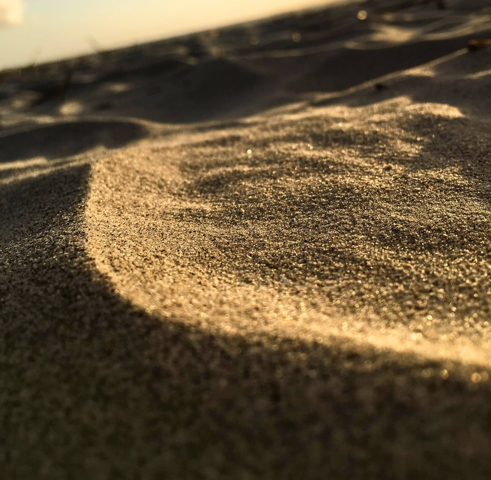 selective focus photo of sand