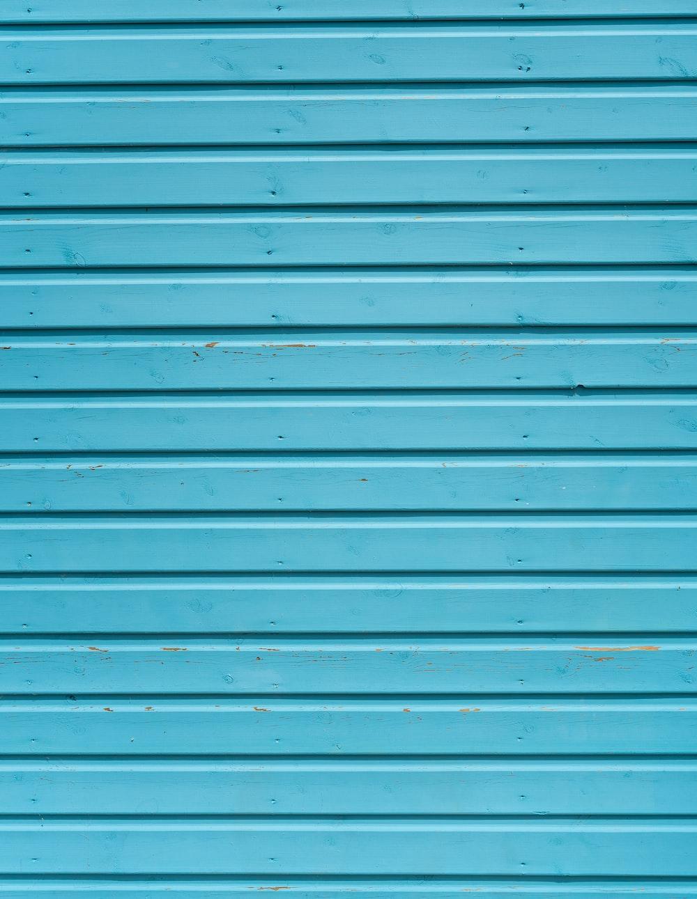 close up photo of teal shutter door