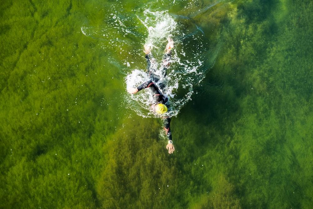 man swimming on water