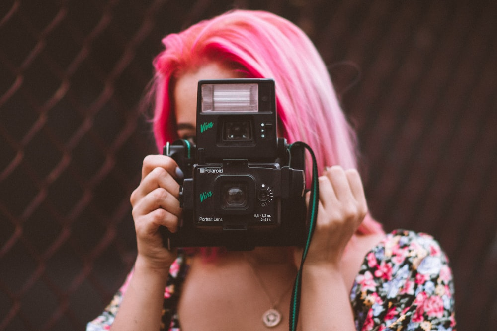woman holding bridge camera