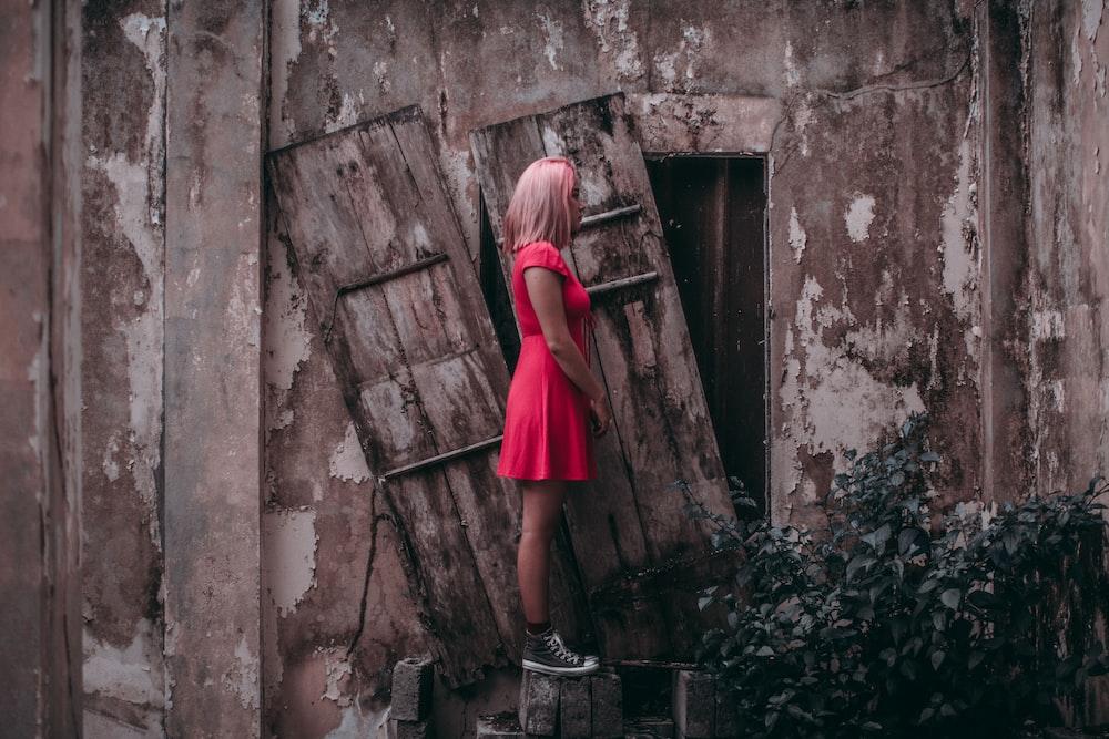 woman facing door