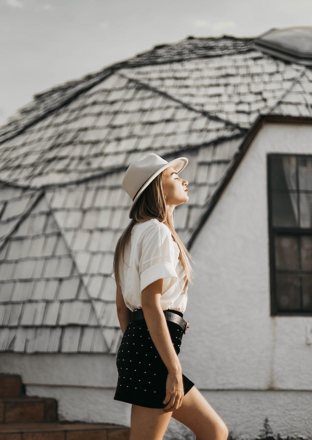 woman wearing white hat