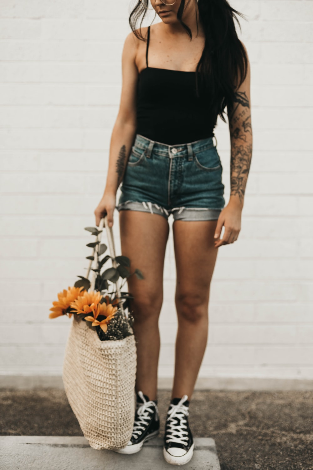 woman standing holding sunflowers