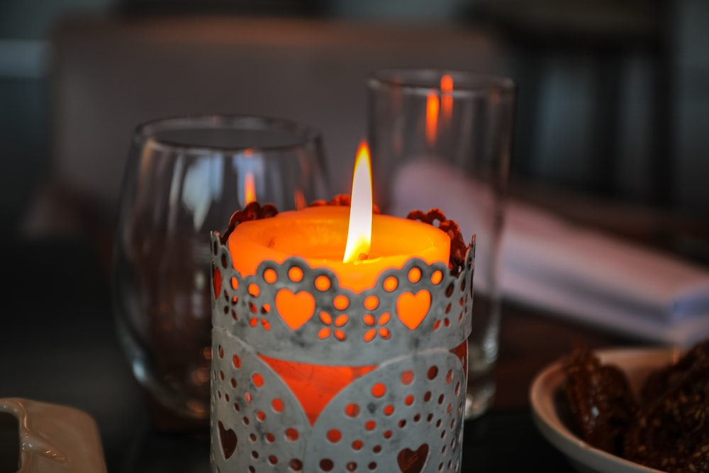 lighted tealight candle near wine glass