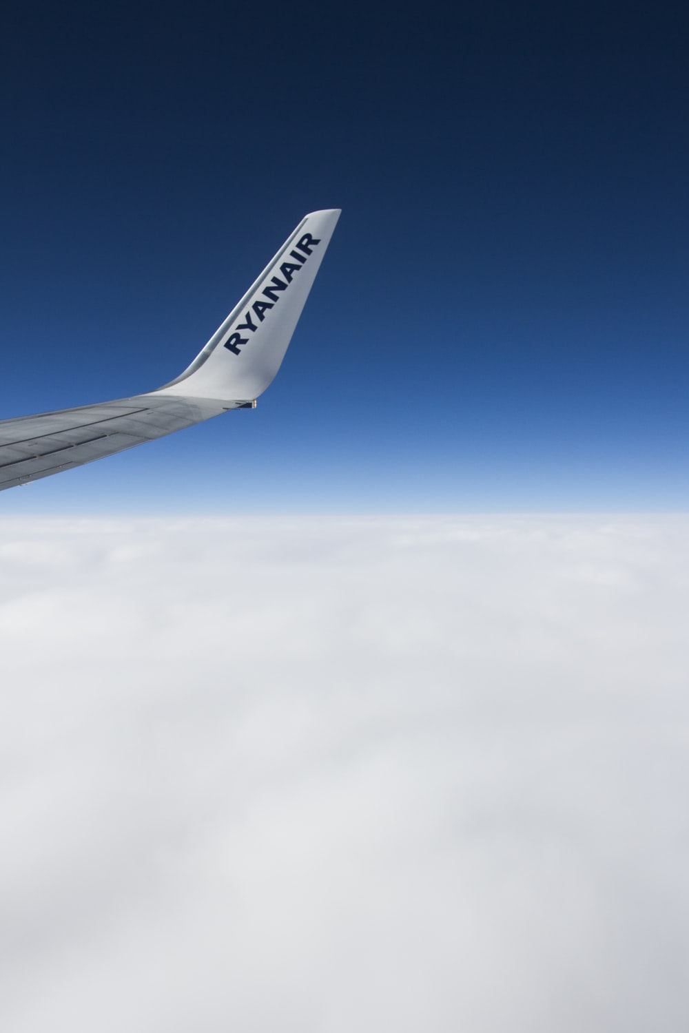 window plane view of sea of clouds