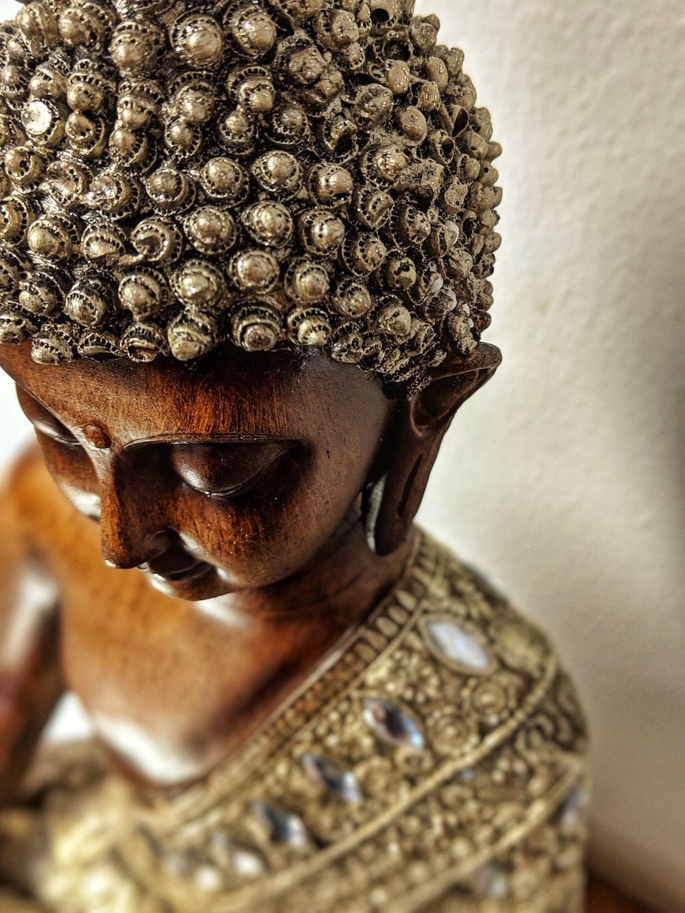 brown wooden buddha statue