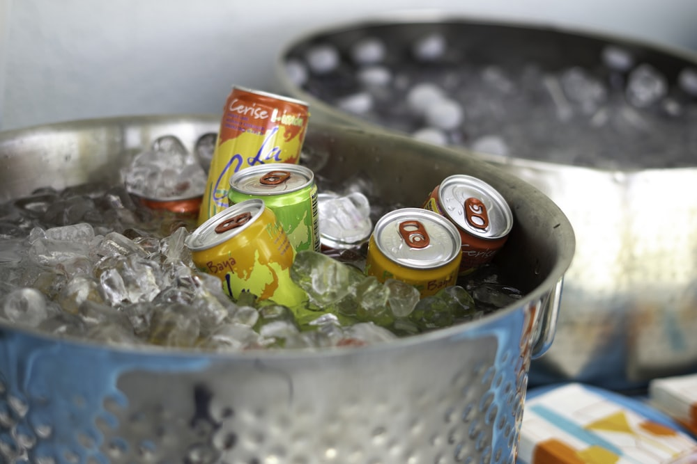 cans in bucket with ice cubes