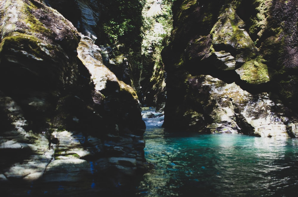 river by rocks during daytime