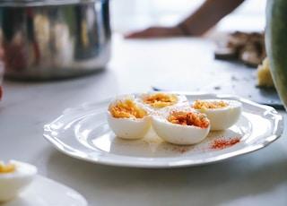 sliced hard boiled eggs on plate