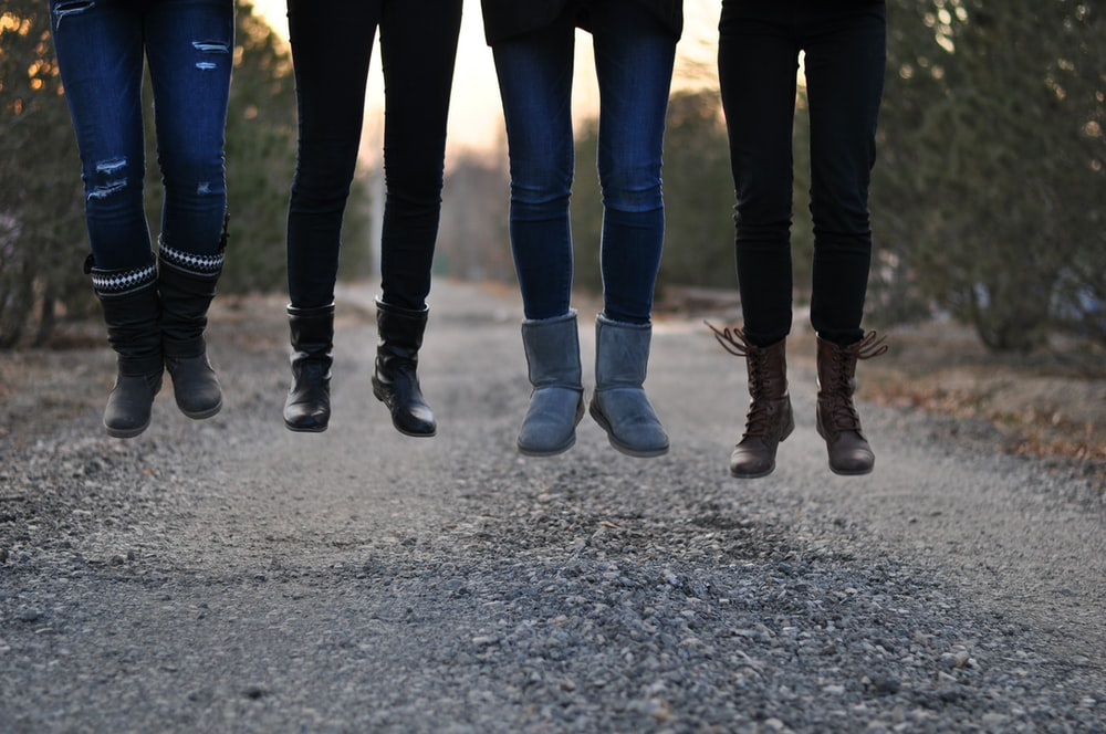four people wearing boots
