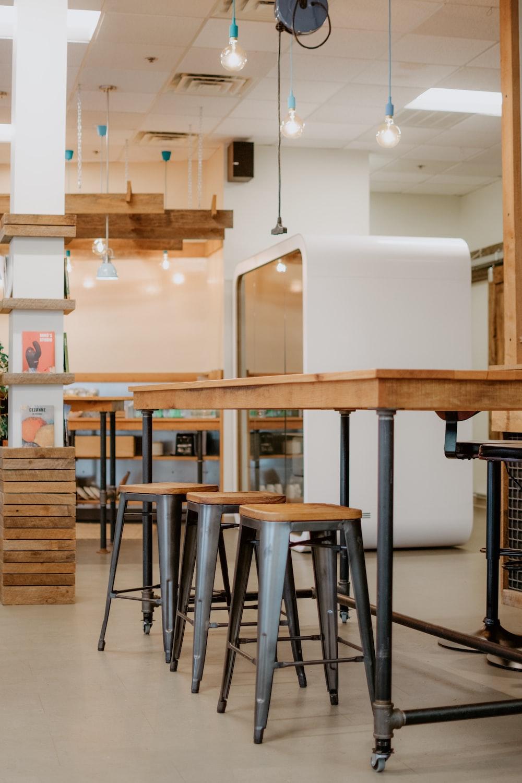 brown wooden and gray metal bar stools