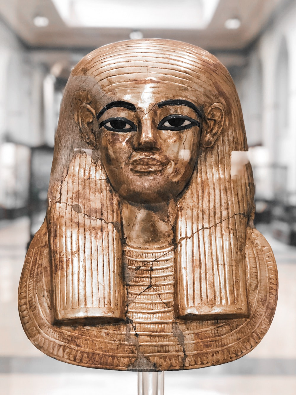 gold-colored pharaoh headbust