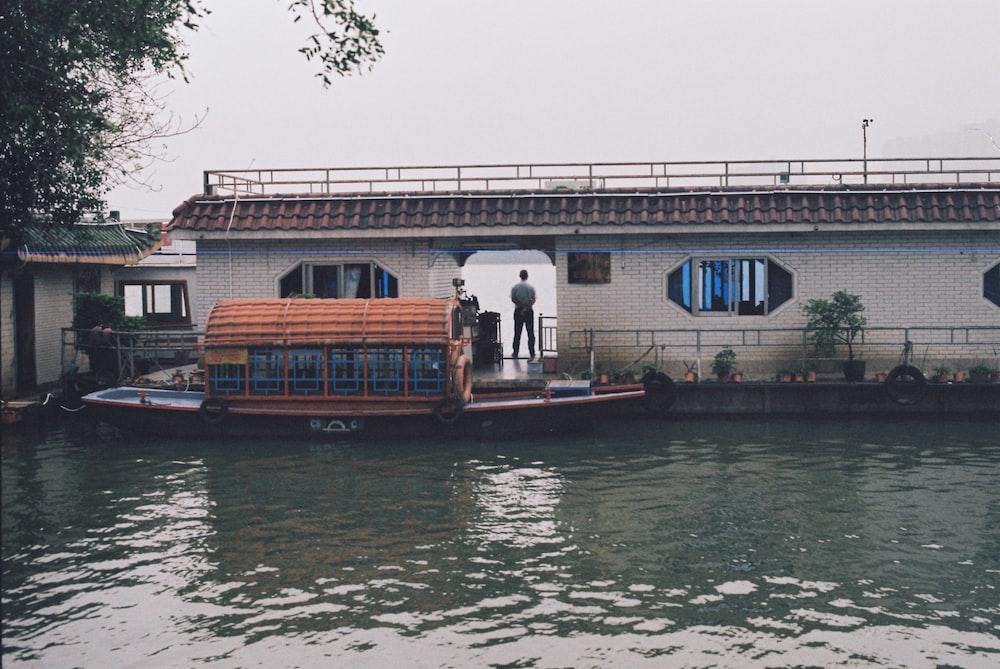 boat docked beside building