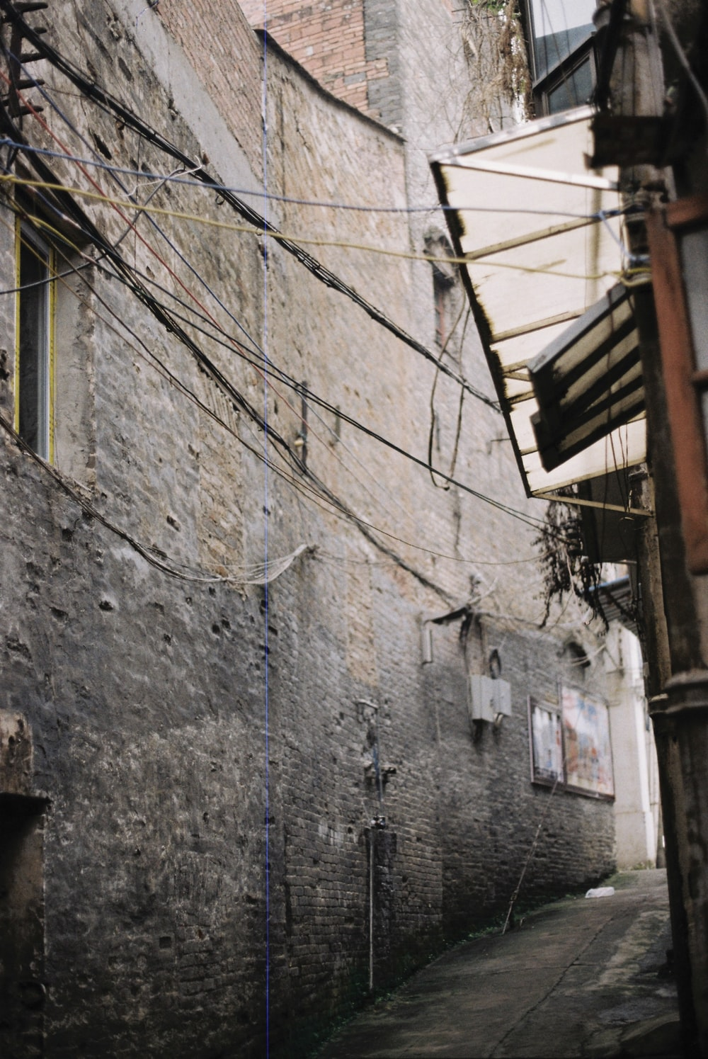 brown and grey wires hanging at alley