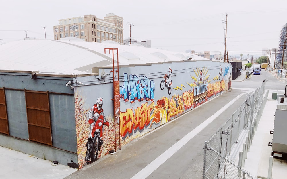 multicolored graffiti wall art on building