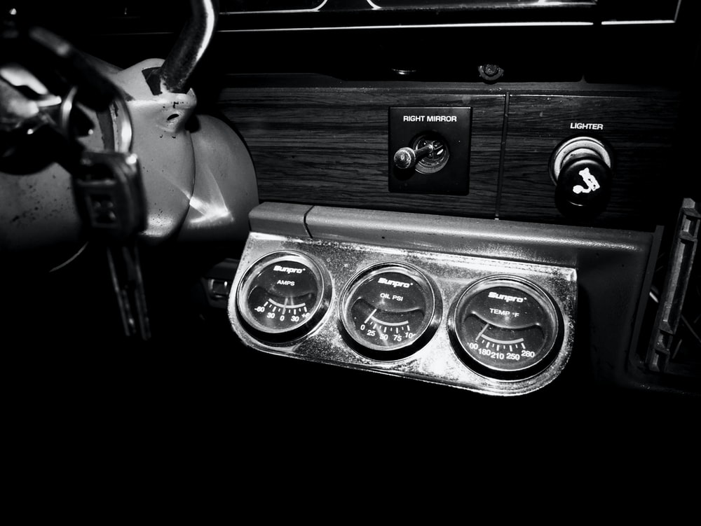 grayscale photography of car instrument panel