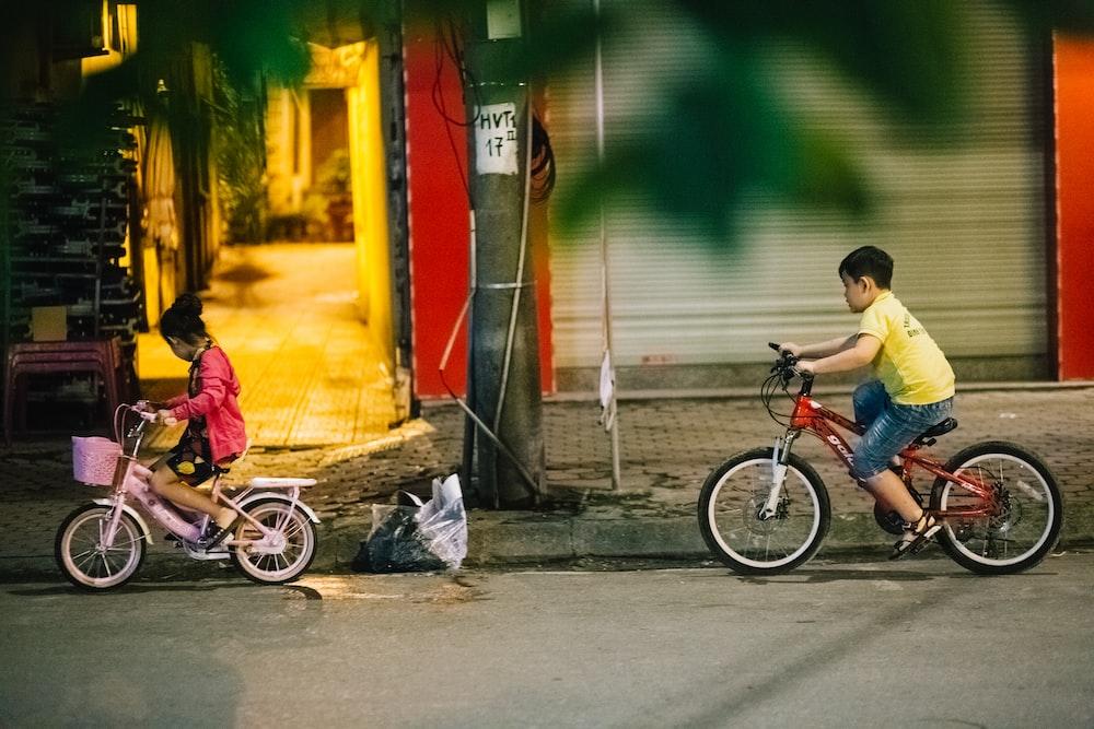two children riding bikes