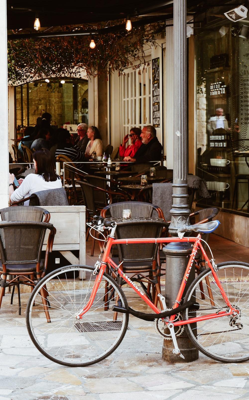 red commuter bike near pole