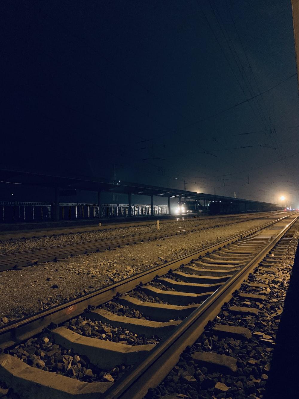 gray train tracks at night