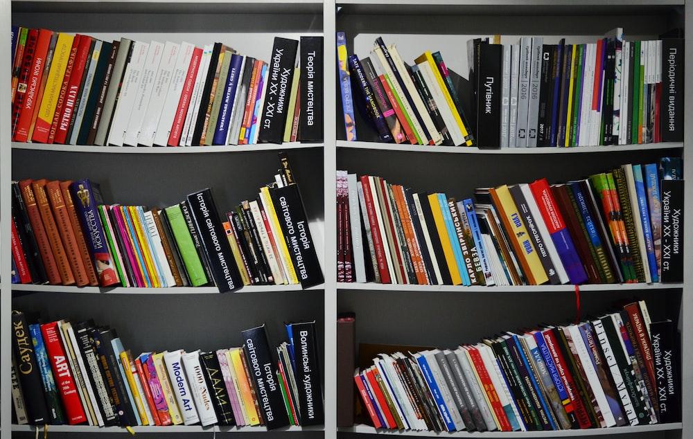 assorted books on a white shelf