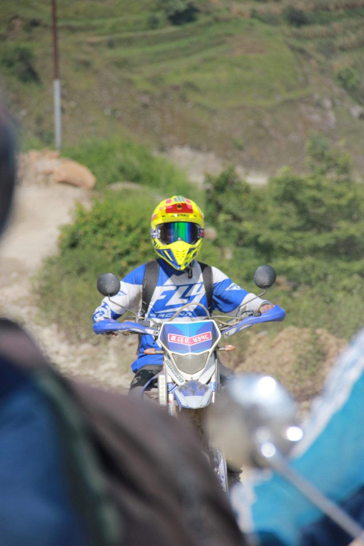man riding on dirt bike