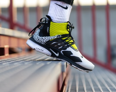 selective focus photography of basketball shoe shoe zoom background