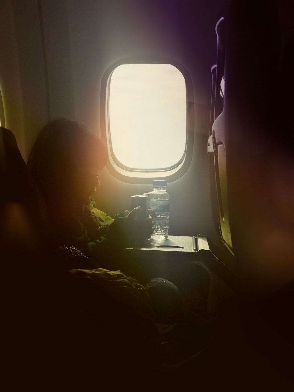 girl by an airplane window