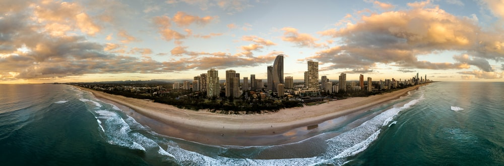 city and beach during day
