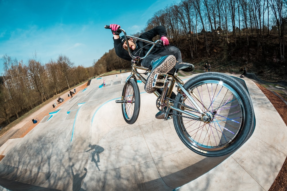 man doing tricks riding on BMX bike
