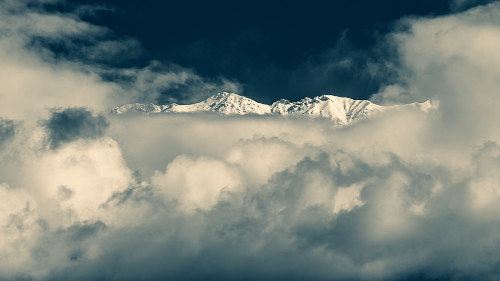 snow mountain covered with clouds