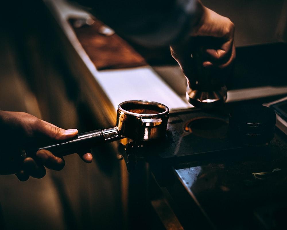 person making a coffee latte