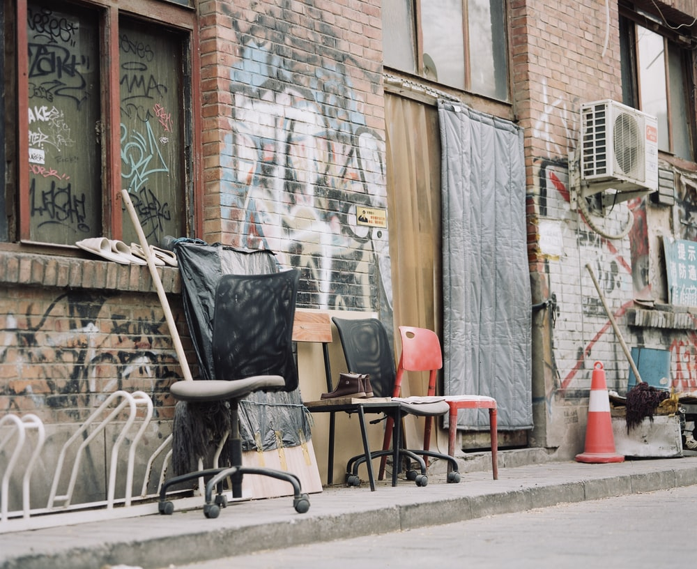 graffiti walls and chairs by a street